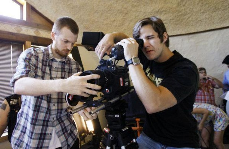 Nik Harper, of Oklahoma City, left, and Mark Johns, of Portland, Ore., adjust a camera as students from a film class at Oklahoma City Community College make a movie titled