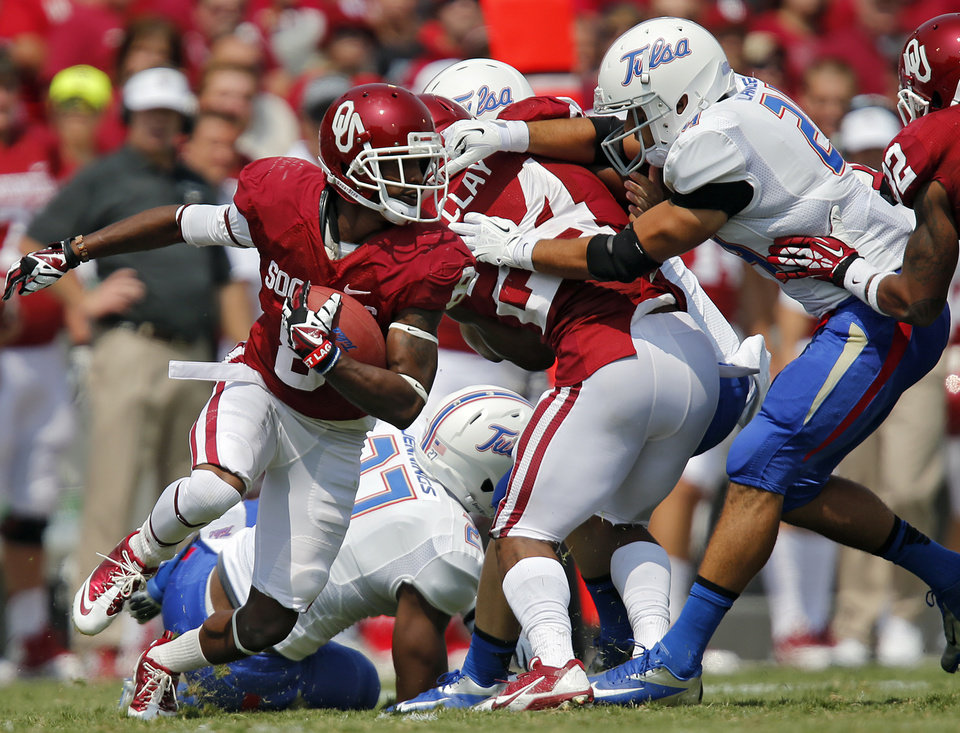 Oklahoma's Jalen Saunders (8) returns a kick during the college football game between the University of Oklahoma Sooners (OU) and the University of Tulsa Hurricanes (TU) at the Gaylord-Family Oklahoma Memorial Stadium on Saturday, Sept. 14, 2013 in Norman, Okla.  Photo by Chris Landsberger, The Oklahoman