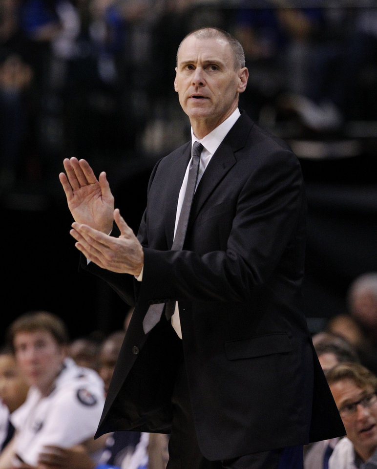 Dallas Mavericks head coach Rick Carlisle cheers on his team in the first half of an NBA basketball game against the Portland Trail Blazers, Monday, Nov. 5, 2012, in Dallas. (AP Photo/Tony Gutierrez)