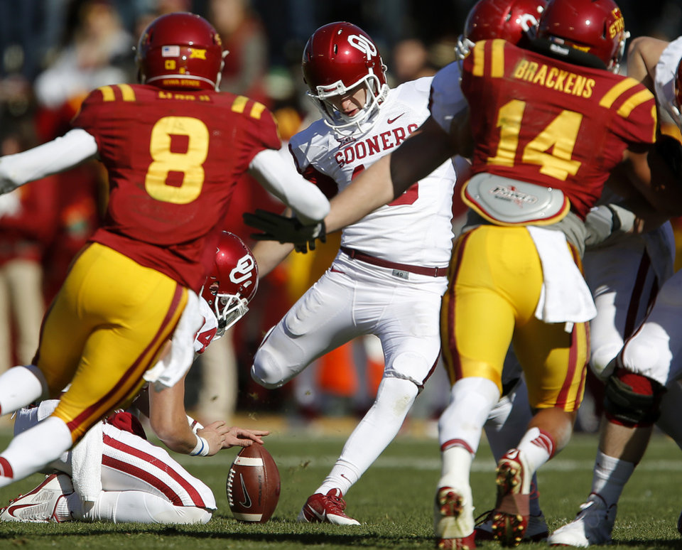 Photo - Oklahoma's Michael Hunnicutt (18) kicks a field goal during a college football game between the University of Oklahoma Sooners (OU) and the Iowa State Cyclones (ISU) at Jack Trice Stadium in Ames, Iowa, Saturday, Nov. 1, 2014. Photo by Bryan Terry, The Oklahoman