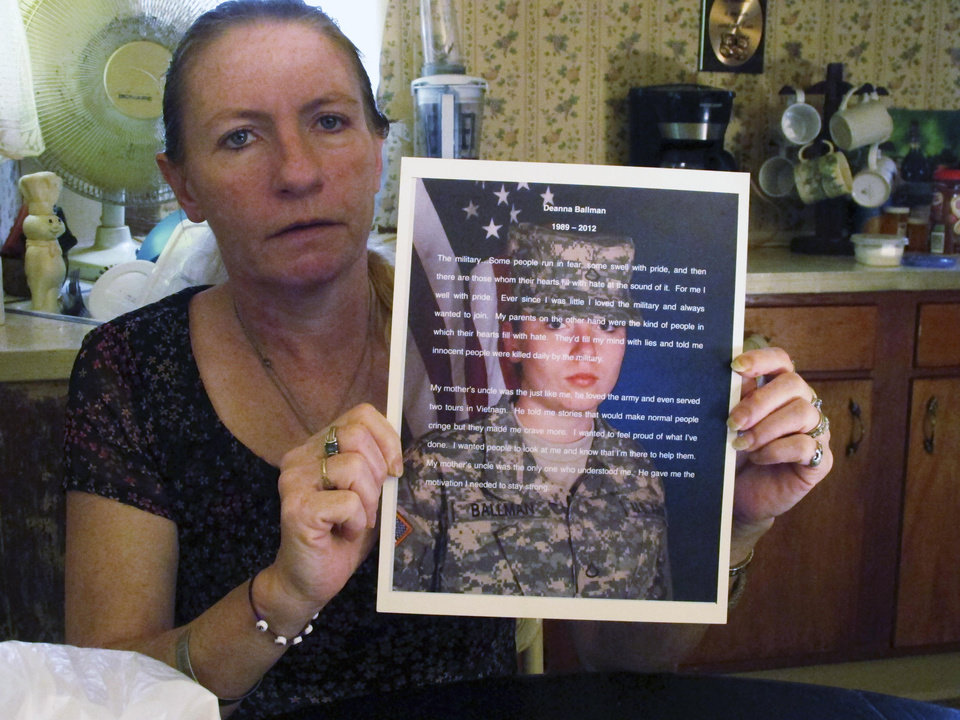 In this May 1, 2013 photo, Lori Ballman holds a tribute to her late daughter, Deanna, at her home in Pataskala, Ohio. Dr. Ali Salim was arrested in February 2013, and charged with kidnapping, raping and killing Ballman in July or August 2012, by injecting her with heroin, as well as killing her unborn child. (AP Photo/Andrew Welsh-Huggins)