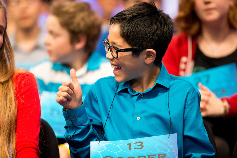 Photo - Cooper Komatsu, 12, of Los Angeles, gives a thumbs up to a speller on stage during the 2015 Scripps National Spelling Bee, Wednesday, May 27, 2015, in Oxon Hill, Md. (AP Photo/Andrew Harnik)