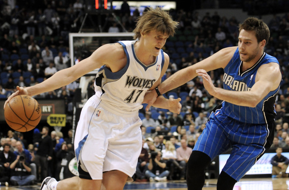 Orlando Magic's Nikola Vucevic, right, of Montenegro, tries to slow down Minnesota Timberwolves' Andrei Kirilenko, of Russia, during the first half of an NBA basketball game Wednesday, Nov. 7, 2012, in Minneapolis. (AP Photo/Jim Mone)