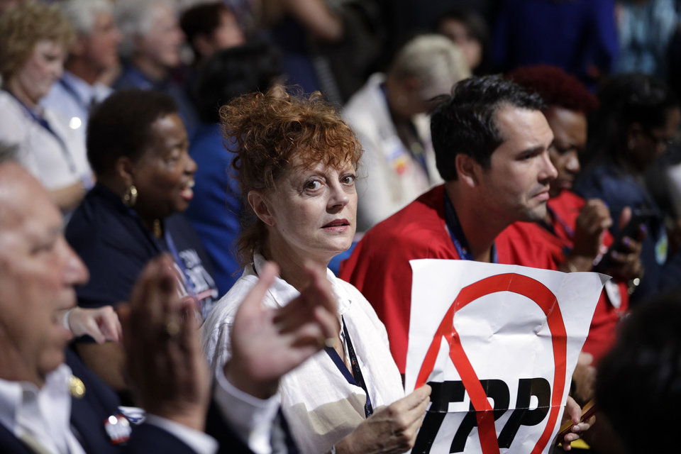 Photo - Actress Susan Sarandon holds up a sign during the first day of the Democratic National Convention in Philadelphia , Monday, July 25, 2016. (AP Photo/John Locher)