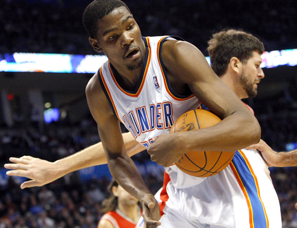 Oklahoma City's Kevin Durant gets a rebound against Houston during their NBA basketball game at the OKC Arena in downtown Oklahoma City on Wednesday, Nov. 17, 2010. Photo by John Clanton, The Oklahoman