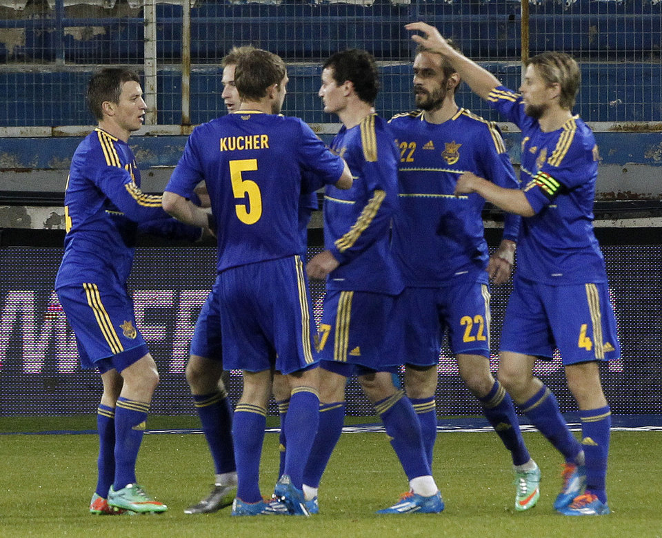 Photo - Players of Ukraine celebrates a goal against U.S. during an international friendly match at Antonis Papadopoulos stadium in southern city of Larnaca, Cyprus, Wednesday, March 5, 2014. The Ukrainians are face the United States in a friendly in Cyprus, a match moved from Kharkiv to Larnaca for security reasons. (AP Photo/Petros Karadjias)