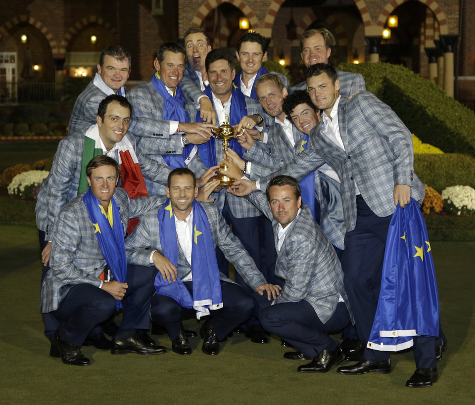 The European team poses with the trophy after winning the Ryder Cup PGA golf tournament Sunday, Sept. 30, 2012, at the Medinah Country Club in Medinah, Ill. (AP Photo/Chris Carlson)  ORG XMIT: PGA257