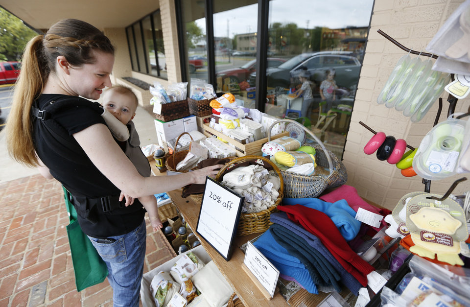 KILLIAN CRAIG / BABY / CHILD / CHILDREN / KIDS / INTERNET SALES TAX: Jessica Craig and her 10-month-old son, Killian shop at the Green Bambino store in Oklahoma City , Friday April 26, 2013. Photo By Steve Gooch, The Oklahoman