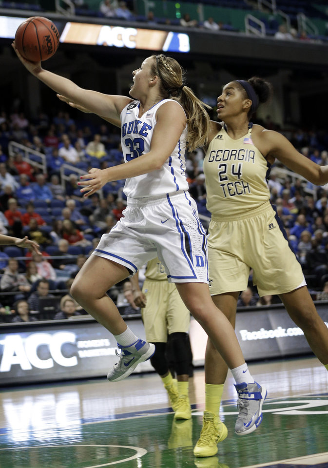 Photo - Duke's Tricia Liston (32) drives past Georgia Tech's Shayla Bivins (24) during the first half of an NCAA college basketball game at the Atlantic Coast Conference tournament in Greensboro, N.C., Friday, March 7, 2014. (AP Photo/Chuck Burton)