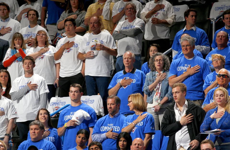 Photo - Fans stand during the national anthem before Game 2 in the first round of the NBA playoffs between the Oklahoma City Thunder and the Memphis Grizzlies at Chesapeake Energy Arena in Oklahoma City, Monday, April 21, 2014. Photo by Nate Billings, The Oklahoman
