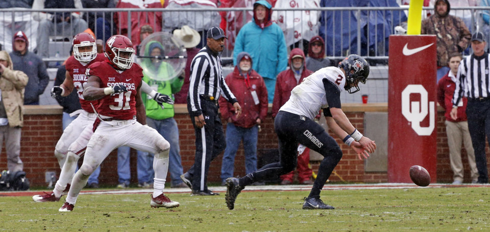 Photo - Oklahoma State's Mason Rudolph (2) fumbles but recovers it himself during the Bedlam college football game between the Oklahoma Sooners (OU) and the Oklahoma State Cowboys (OSU) at Gaylord Family - Oklahoma Memorial Stadium in Norman, Okla., Saturday, Dec. 3, 2016. Photo by Steve Sisney, The Oklahoman