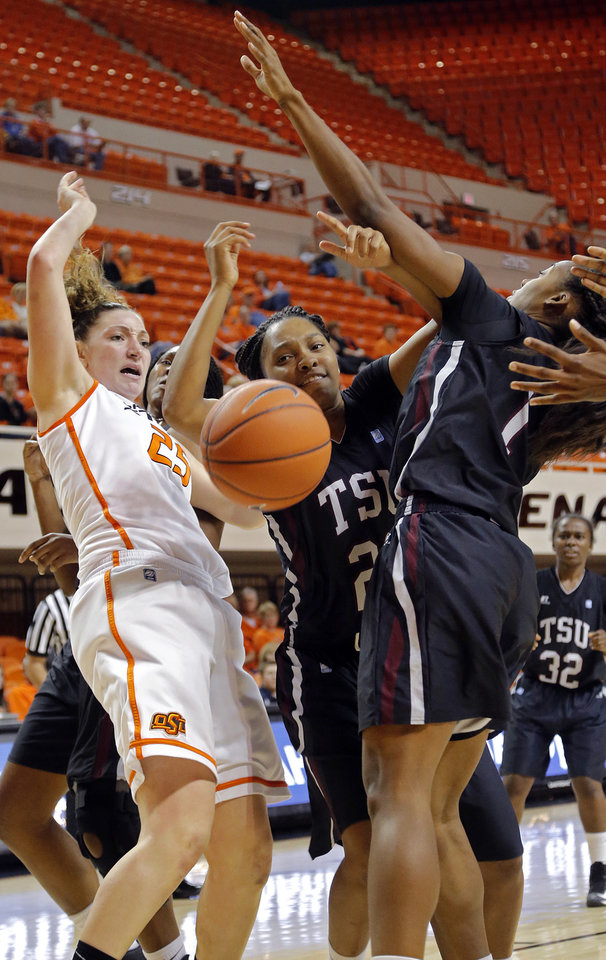 Oklahoma State 's Lindsey Keller (25) battles for a loose ball with Texas Southern 's Te'era Williams (21) and Brianna Sidney (1) during the women's college basketball game between Oklahoma State University and Texas Southern University on Saturday, Dec. 1, 2012, in Stillwater, Okla.   Photo by Chris Landsberger, The Oklahoman
