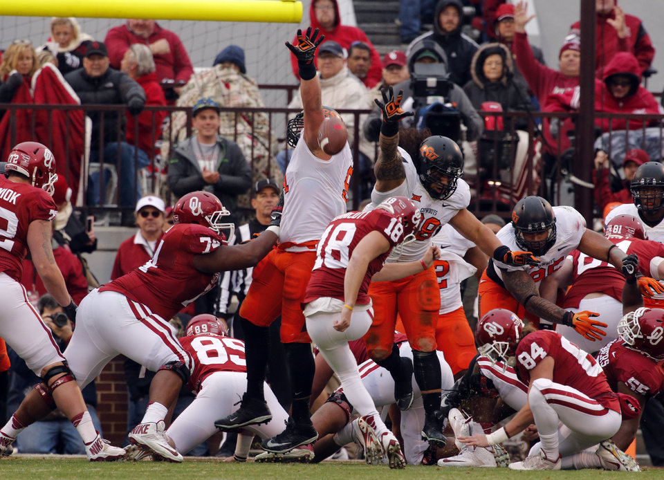 Photo - Sooner's Michael Hunnicutt (18) kicks an extra point during a Bedlam college football game between the University of Oklahoma Sooners (OU) and the Oklahoma State Cowboys (OSU) at Gaylord Family-Oklahoma Memorial Stadium in Norman, Okla., on Saturday, Dec. 6, 2014. Photo by Steve Sisney, The Oklahoman