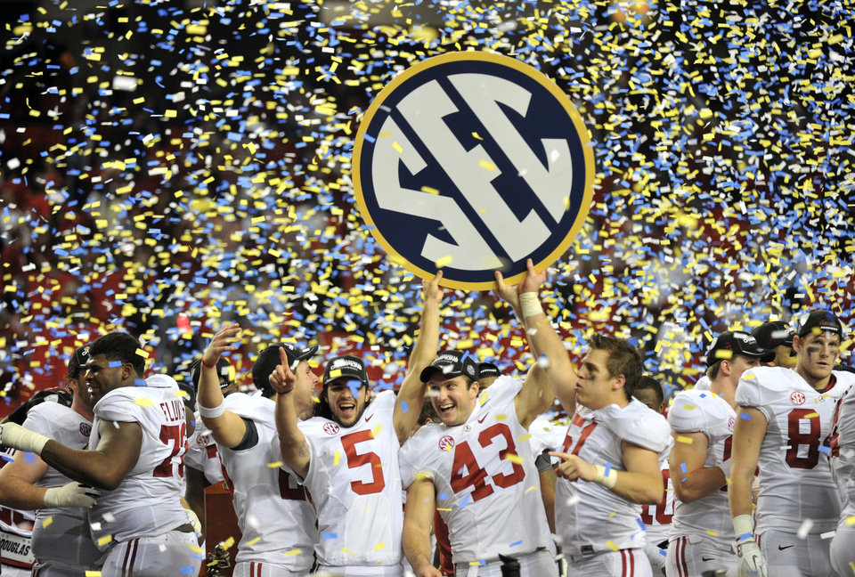 Alabama players  celebrates after their 32-28 win in the Southeastern Conference championship NCAA college football game against Georgia, Saturday, Dec. 1, 2012, in Atlanta. (AP Photo/Atlanta Journal-Constitution, Hyosub Shin)  MARIETTA DAILY OUT; GWINNETT DAILY POST OUT; LOCAL TV OUT; WXIA-TV OUT; WGCL-TV OUT