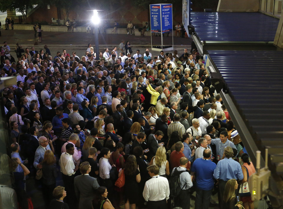 Photo - Hundreds of delegates wait outside of Time Warner Cable Arena as the entrance is closed during the Democratic National Convention in Charlotte, N.C., on Wednesday, Sept. 5, 2012. (AP Photo/Jae C. Hong)  ORG XMIT: DNC762