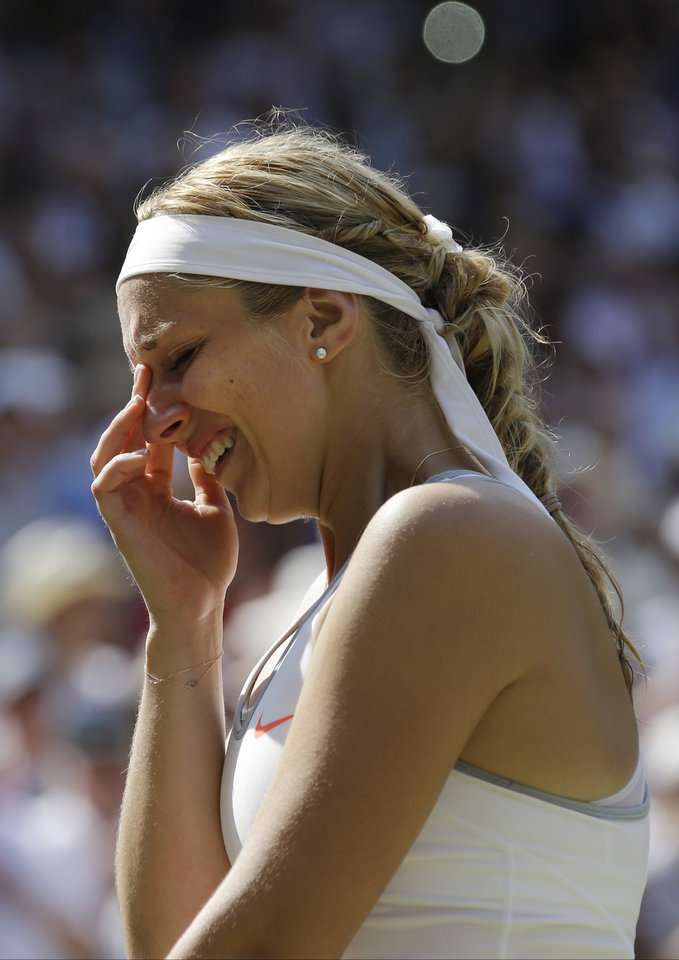 Sabine Lisicki of Germany reacts as she is interviewed during the trophy ceremony after losing to Marion Bartoli of France in the Women's singles final match at the All England Lawn Tennis Championships in Wimbledon, London, Saturday, July 6, 2013.  (AP Photo/Anja Niedringhaus)