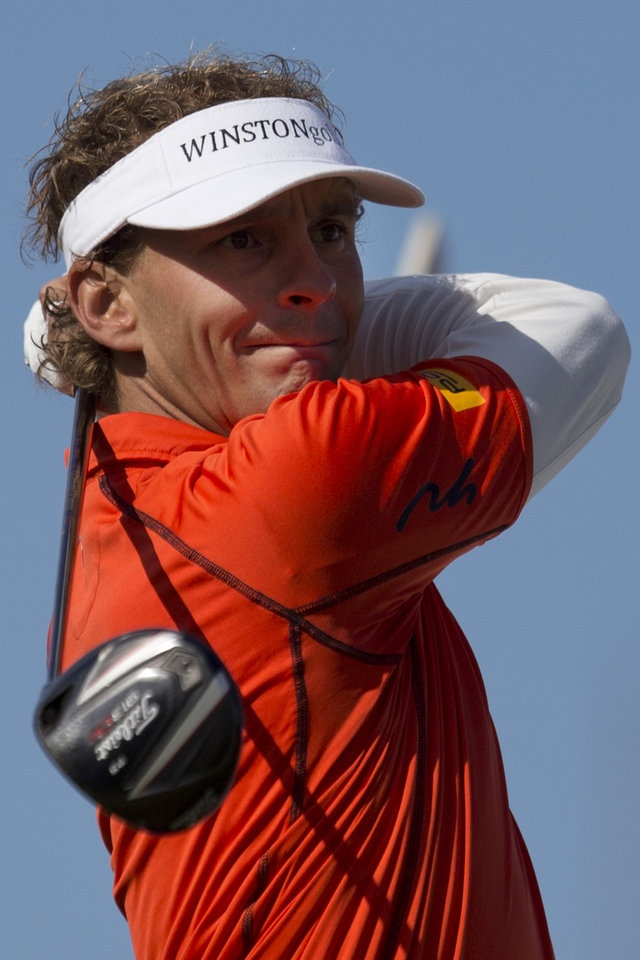 Photo - Netherlands' Joost Luiten tees off on hole two during the final round of the KLM Open men's golf tournament in the beach resort of Zandvoort, western Netherlands, Sunday, Sept. 15, 2013. (AP Photo/Peter Dejong)