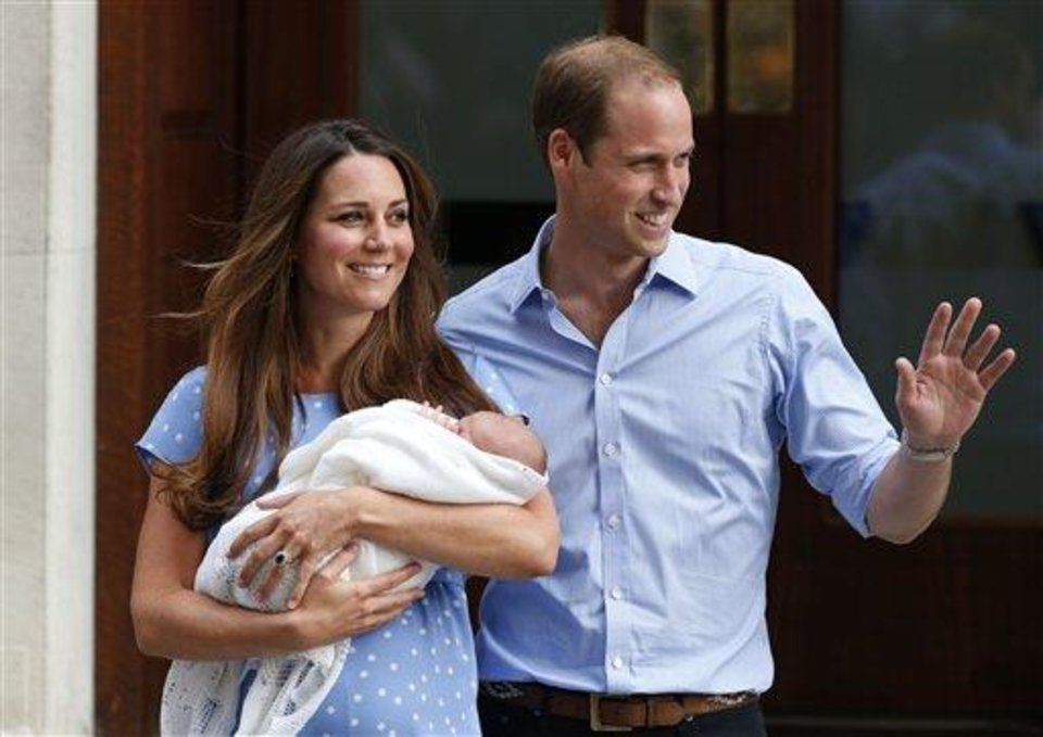 Photo - Prince William and Kate, Duchess of Cambridge hold the Prince of Cambridge, Tuesday as they pose for photographers outside St. Mary's Hospital exclusive Lindo Wing in London. (AP Photo/Lefteris Pitarakis)