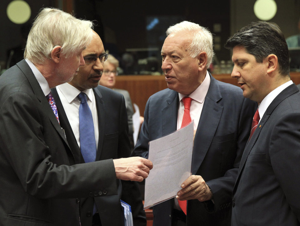 Photo - Spain's Foreign Minister Jose Manuel Garcia-Margallo y Marfil, second right, talks with Finland's Foreign Minister Erkki Sakari Tuomioja, left, French Secretary of State for European Affairs Harlem Desir, second left, and Romania's Foreign Minister Titus Corlatean during an EU foreign ministers meeting at the European Council building in Brussels Monday, May 12, 2014. EU foreign ministers discuss the situation in Ukraine. (AP Photo/Yves Logghe)
