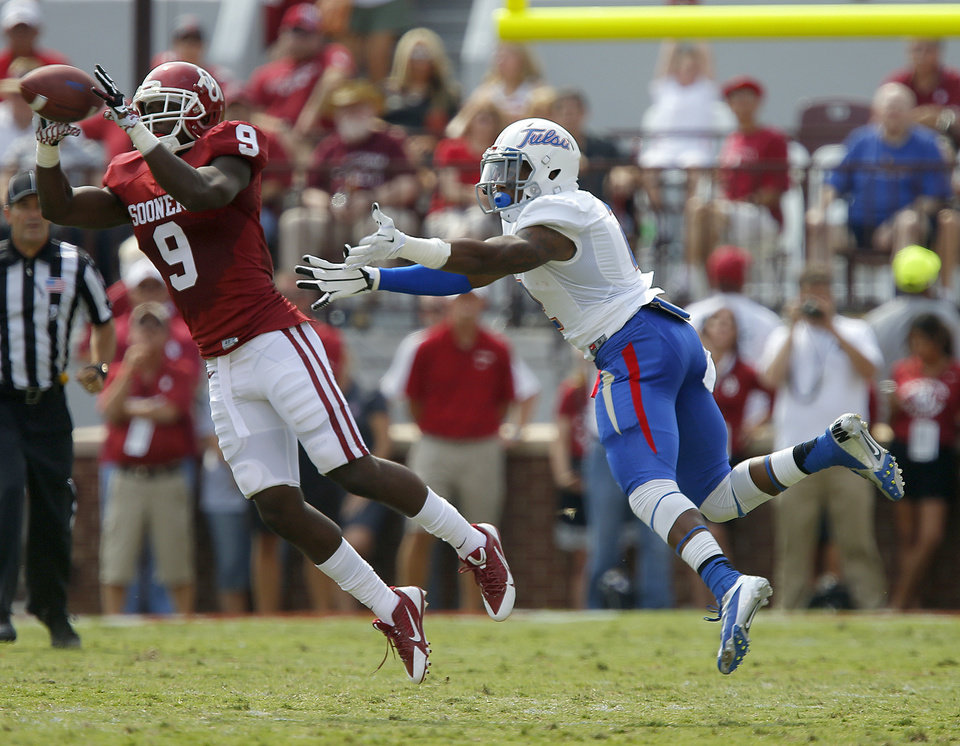 Oklahoma's Gabe Lynn (9) intercepts a pass intended for Tulsa's Keevan Lucas (2) during a college football game between the University of Oklahoma Sooners (OU) and the Tulsa Golden Hurricane at Gaylord Family-Oklahoma Memorial Stadium in Norman, Okla., on Saturday, Sept. 14, 2013. Photo by Bryan Terry, The Oklahoman