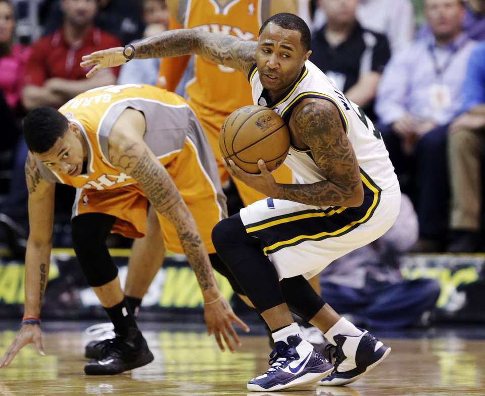 Utah Jazz's Mo Williams, right, grabs a loose ball as Phoenix Suns' Diante Garrett (10) watches in the second quarter during an NBA basketball game, Wednesday, March 27, 2013, in Salt Lake City.  (AP Photo/Rick Bowmer)