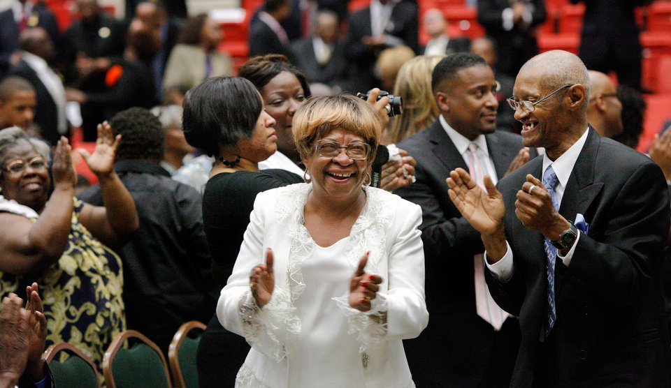 Photo - Daughter Marilyn Luper Hildreth  got up from her chair and celebrated with other family members at the end of an impassioned speech by fellow civil rights activist and protege of Luper, Rev. Amos Brown.  About 2,500 people celebrated the life and legacy of Oklahoma City civil rights pioneer Clara Mae Shepard Luper  during a lively service in the Cox Convention Center that lasted more than three hours, Friday,  June 17, 2011.  Luper died  last week at the age of 88. Photo by Jim Beckel, The Oklahoman
