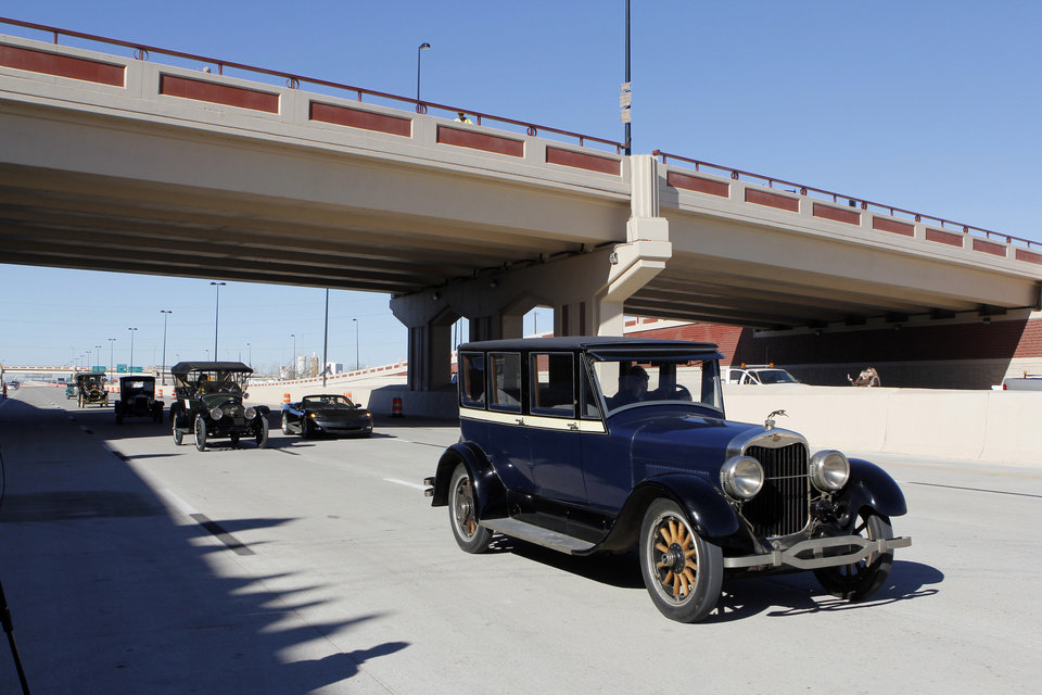 Antique cars cross under the Western Ave. Bridge during grand opening ceremonies for the east bound lanes of the I-40 Crosstown in Oklahoma City Thursday, Jan. 5, 2012. Photo by Paul B. Southerland, The Oklahoman