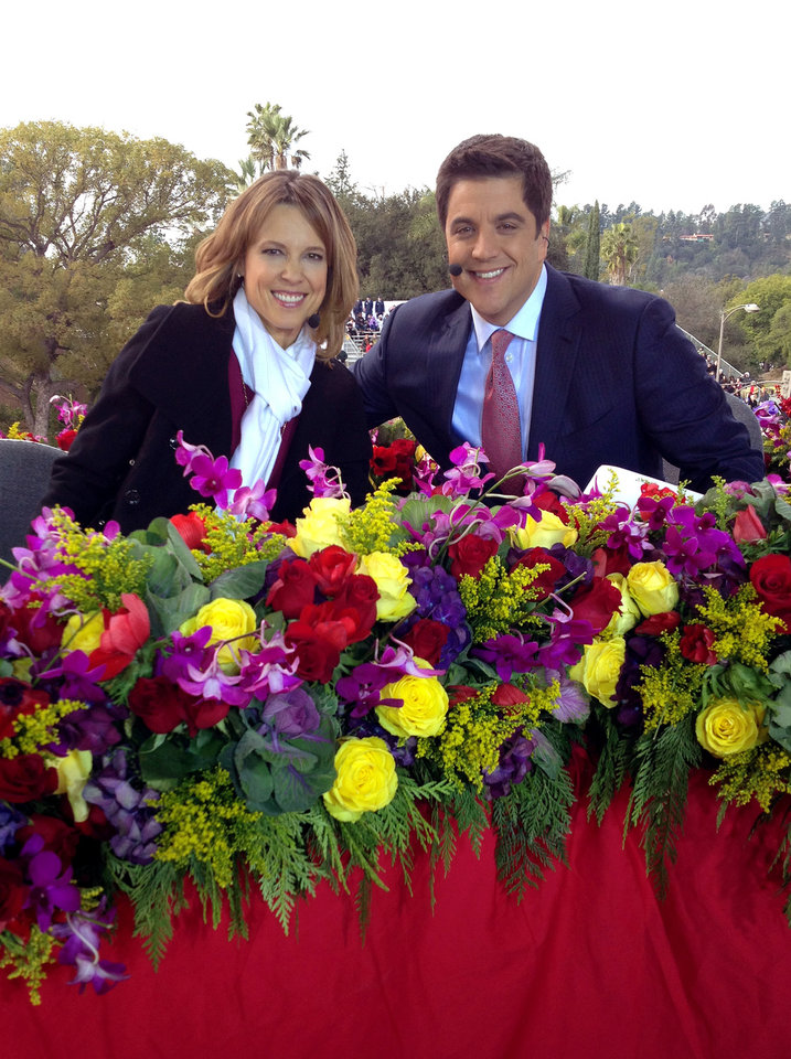 Photo - In this photo provided by Hannah Storm, ESPN anchor Hannah Storm, left, poses for a photo with co-host Josh Elliott, anchor for ABC's Good Morning America, on the parade grounds of the Rose Parade on Tuesday, Jan. 1, 2013, in Pasadena, Calif. Storm hosted the Rose Parade telecast Tuesday in her first on-air appearance since sustaining first- and second-degree burns to her face, hands, chest and neck in a propane gas grill accident Dec. 11. (AP Photo/Courtesy Hannah Storm)