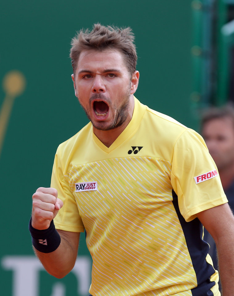 Photo - Stanislas Wawrinka of Switzerland celebrates after winning a point against  David Ferrer of Spain, during their semifinal match of the Monte Carlo Tennis Masters tournament in Monaco, Saturday, April, 19, 2014. Wavrinka won 6-1, 7-6. (AP Photo/Claude Paris)