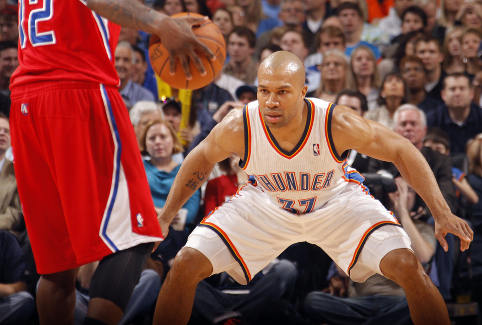 Photo - L.A. CLIPPERS: Oklahoma City's Derek Fisher (37) defends on Los Angeles Clippers point guard Eric Bledsoe (12) during the NBA basketball game between the Oklahoma City Thunder and the Los Angeles Clippers at Chesapeake Energy Arena on Wednesday, March 21, 2012 in Oklahoma City, Okla.  Photo by Chris Landsberger, The Oklahoman
