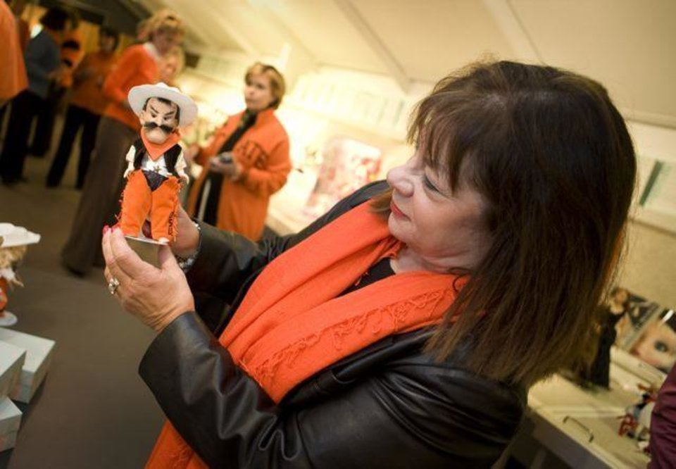 OSU RECEPTION....Gale Jarvis shows Pistol Pete, a new Madame  Alexander doll. (Photo by Gary Lawson, OSU.).