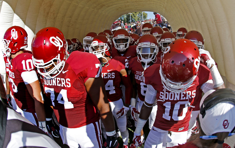 Photo - The Oklahoma football team wants to take the field before a college football game between the University of Oklahoma Sooners (OU) and the Louisiana Tech Bulldogs at Gaylord Family-Oklahoma Memorial Stadium in Norman, Okla., on Saturday, Aug. 30, 2014. Photo by Bryan Terry, The Oklahoman