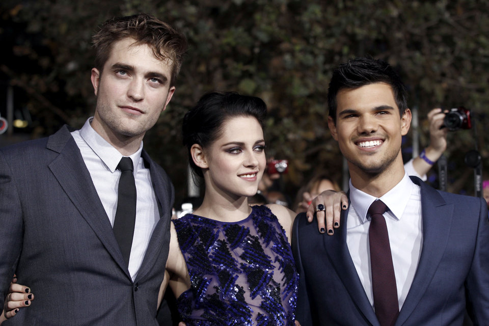 "Robert Pattinson, left, Kristen Stewart, center, and Taylor Lautner arrive at the world premiere of ""The Twilight Saga: Breaking Dawn - Part 1"" on Monday, Nov. 14, 2011, in Los Angeles. (AP Photo/Matt Sayles) ORG XMIT: CASH180"