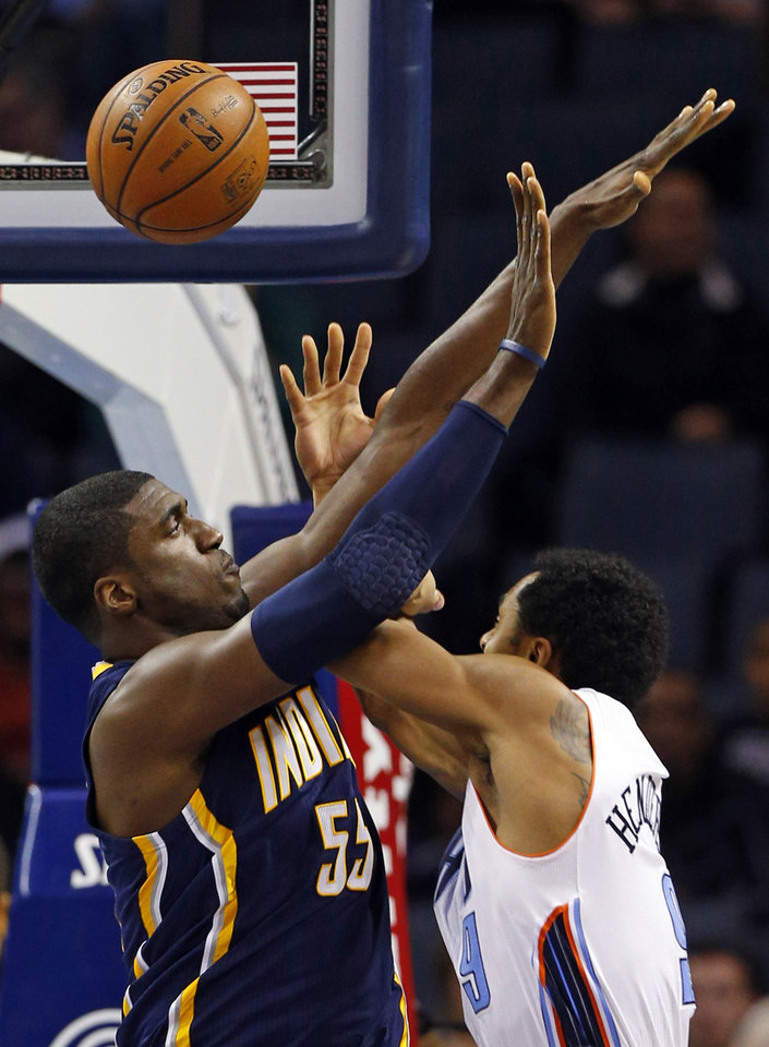 Indiana Pacers' Roy Hibbert (55) fouls Charlotte Bobcats' Gerald Henderson (9) during the first half of an NBA basketball game in Charlotte, N.C., Tuesday, Jan. 15, 2013. (AP Photo/Chuck Burton)