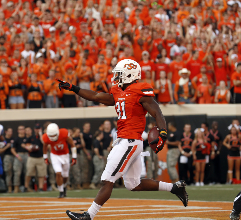 Oklahoma State's Jeremy Smith (31) celebrates a touchdown during a college football game between Oklahoma State University (OSU) and Savannah State University at Boone Pickens Stadium in Stillwater, Okla., Saturday, Sept. 1, 2012. Photo by Sarah Phipps, The Oklahoman