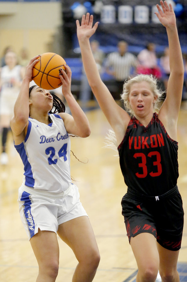 Photo - Deer Creek's Skylar Vann shoots  as Yukon's Kristen Readel defends during the girls high school basketball game between Deer Creek and Yukon at Deer Creek High School, Tuesday, Feb. 18, 2020.  [Sarah Phipps/The Oklahoman]