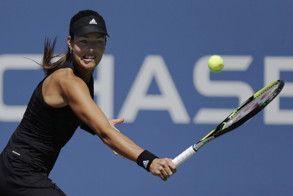 Photo - Ana Ivanovic, of Serbia, returns a shot against Kirolina Pliskova, of the Czech Republic, during the second round of the 2014 U.S. Open tennis tournament, Thursday, Aug. 28, 2014, in New York. (AP Photo/Frank Franklin II)