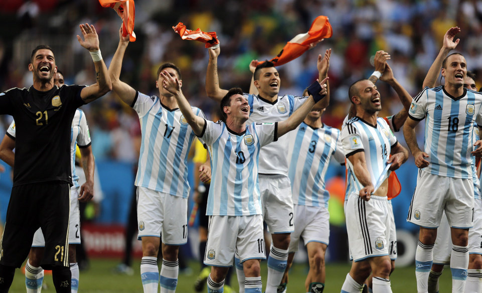 Photo - CORRECTS PHOTOGRAPHER'S BYLINE - Argentina's Lionel Messi and teammates celebrate at the end of the World Cup quarterfinal soccer match between Argentina and Belgium at the Estadio Nacional in Brasilia, Brazil, Saturday, July 5, 2014. Argentina won 1-0. (AP Photo/Eraldo Peres)