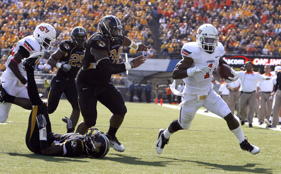 Photo - Oklahoma State's Joseph Randle (1) gets by the Missouri defense for a touchdown during a college football game between the Oklahoma State University Cowboys (OSU) and the University of Missouri Tigers (Mizzou) at Faurot Field in Columbia, Mo., Saturday, Oct. 22, 2011. Photo by Sarah Phipps, The Oklahoman