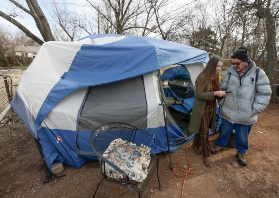 Photo - Jamie Zumwalt, 51, founder and pastor of Joe's Addiction, left, talks to Luther, 52, who preferred to not give his last name, as lunch was being served out of a tent at 6100 S Cox, near the original location of Joe's Addiction, in Valley Brook, Okla., Monday, Dec. 23, 2019. While the new site for Joe's Addiction is not ready, Zumwalt continues to help the community of people in need who were being served by Joe's Addiction. [Nate Billings/The Oklahoman]