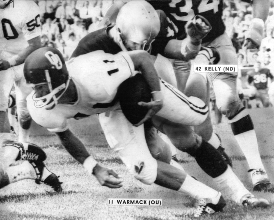 Sooner quarterback Bob Warmack is smothered after a four-yard gain as the Sooners lost their 1968 season opener, 45-21, to the Fighting Irish of Notre Dame in South Bend. PHOTO FROM THE OKLAHOMAN ARCHIVES