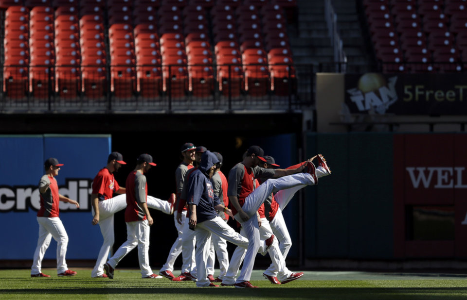 Photo - Members of the St. Louis Cardinals warm up at the start of a baseball practice Sunday, Oct. 20, 2013, in St. Louis. The Cardinals are preparing to play the Boston Red Sox in Game 1 of the World Series on Wednesday in Boston. (AP Photo/Jeff Roberson)