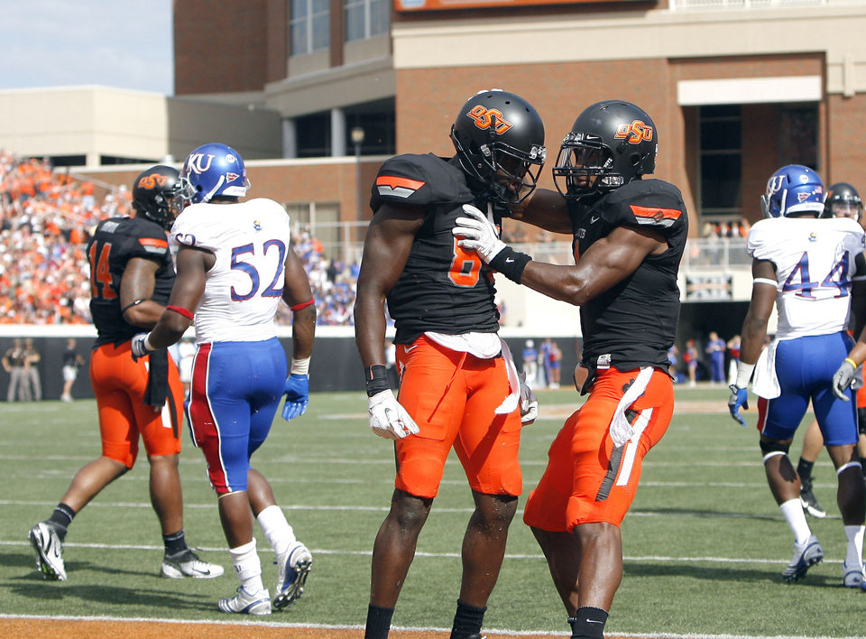 Photo - Oklahoma State's Hubert Anyiam (84) and Joseph Randle (1) celebrate a touchdown during the first half of the college football game between the Oklahoma State University Cowboys (OSU) and the University of Kansas Jayhawks (KU) at Boone Pickens Stadium in Stillwater, Okla., Saturday, Oct. 8, 2011. Photo by Sarah Phipps, The Oklahoman