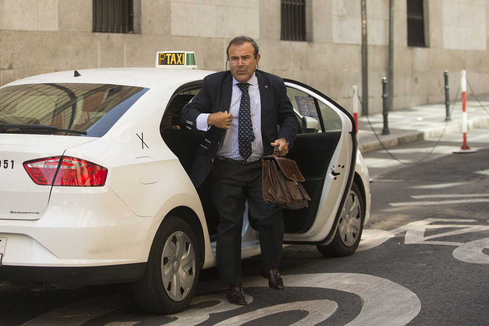 Photo - Ashya King parents's lawyer, Juan Isidro Fernandez Diaz, arrives at the National court in Madrid, Spain, Monday, Sept. 1, 2014.  A critically-ill 5-year-old boy driven to Spain by his parents, Brett and Naghemeh, against doctors' advice is receiving medical treatment for a brain tumor in a Spanish hospital as his parents await extradition to Britain, police said Sunday. Officers received a phone call late Saturday from a hotel east of Malaga advising that a vehicle fitting the description circulated by police was on its premises. Both parents were arrested and the boy, Ashya King, was taken to a hospital, a Spanish police spokesman said. (AP Photo/Andres Kudacki)