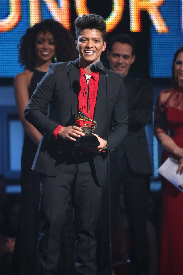 """Photo - Bruno Mars accepts the award for best pop vocal album for """"Unorthodox Jukebox"""" at the 56th annual Grammy Awards at Staples Center on Sunday, Jan. 26, 2014, in Los Angeles. (Photo by Matt Sayles/Invision/AP)"""