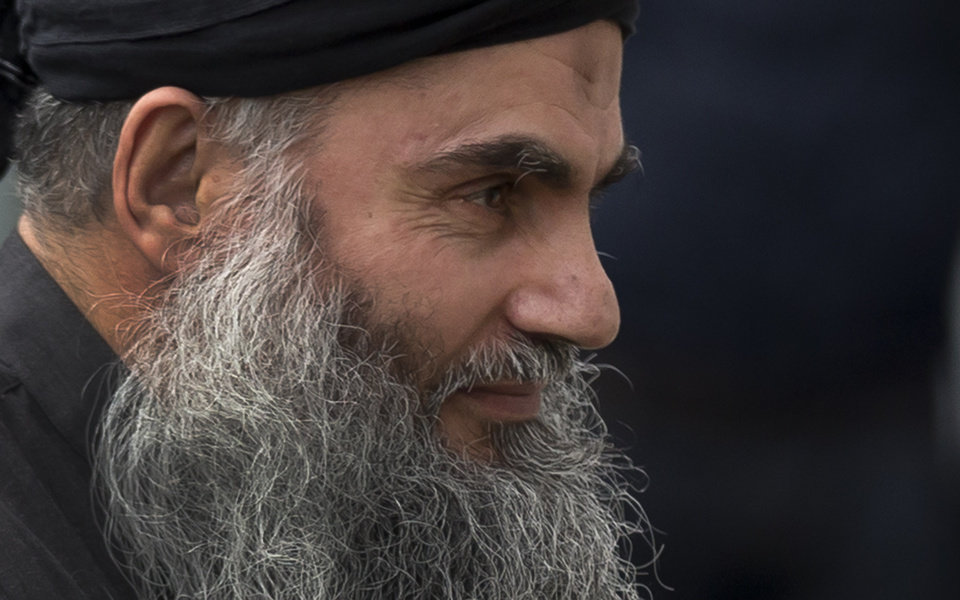 Photo - FILE - This is a Tuesday, Nov. 13, 2012. file photo of  Radical Islamist cleric Abu Qatada arrives back at his residence in London after being freed from prison, Tuesday, Nov. 13, 2012. The British government on Monday Dec. 3, 2012 is challenging a court ruling that it cannot deport to Jordan the radical Islamist cleric Abu Qatada, who has been described by prosecutors as a key al-Qaida operative in Europe. (AP Photo/Matt Dunham, File)