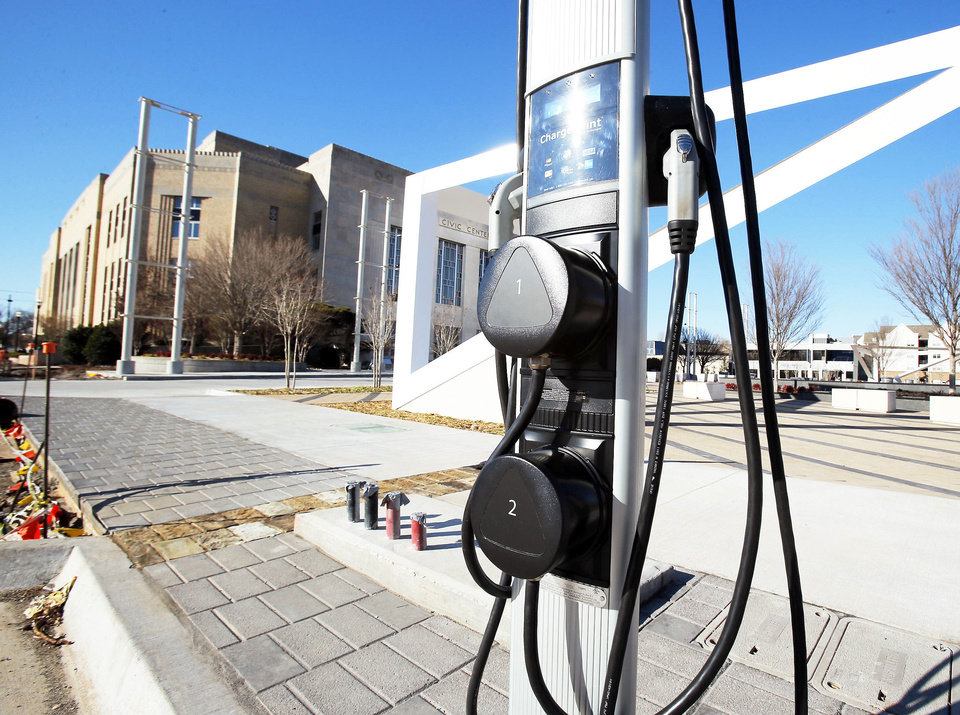 Photo - An automobile charging station  is located on the street beside Bicentennial Park on Thursday, Jan. 3, 2013  in Oklahoma City, Okla. Photo by Steve Sisney, The Oklahoman