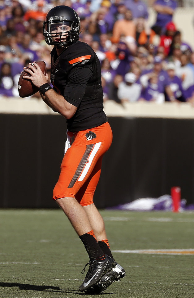 Oklahoma State\'s J.W. Walsh (4) looks to throw a pass in the second quarter during a college football game between the Oklahoma State University Cowboys (OSU) and the Kansas State University Wildcats (KSU) at Boone Pickens Stadium in Stillwater, Okla., Saturday, Oct. 5, 2013. Photo by Sarah Phipps, The Oklahoman