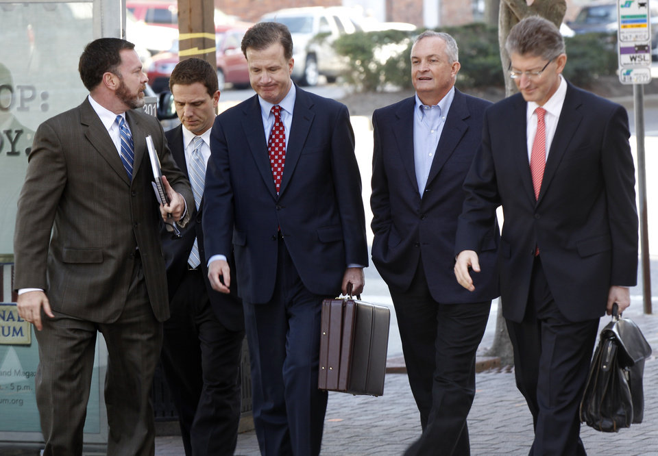 Robert Kaluza, second from right, a BP well site leader from the Deepwater Horizon oil rig explosion, arrives with his legal team at Federal Court to be arraigned on manslaughter charges in New Orleans, Wednesday, Nov. 28, 2012. (AP Photo/Gerald Herbert)