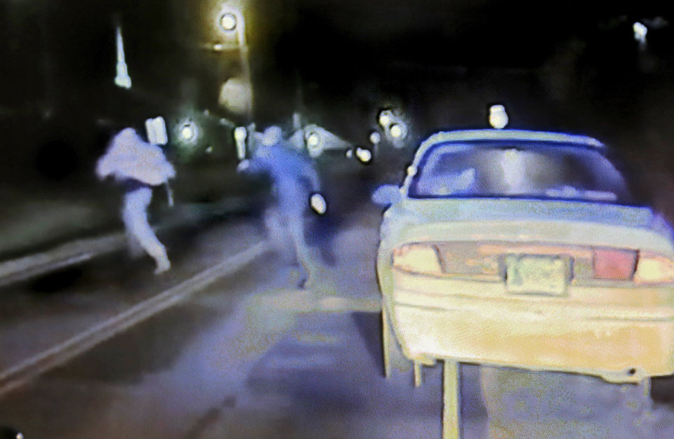 Photo - This image from dash cam video clearly shows Tecumseh Officer Justin Terney chasing suspect Byron Shepherd into a field after Shepherd gave Terney a false name and then decided to try to escape during a traffic stop. The man accused of shooting and killing a Tecumseh police officer last Sunday night has been charged with murder. Byron James Shepard, 35, faces one count of first-degree murder in Pottawatomie County District Court.